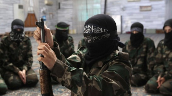 A female member of the Ahbab Al-Mustafa Battalion assembles a rifle during military training in a mosque in the Seif El Dawla neighbourhood in Aleppo