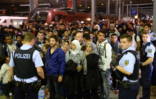 epa04926594 Refugees gather together after arriving from Budapest, Hungary, to the main station in Munich, Germany, 12 September 2015. EU President Donald Tusk said he would call a special summit on the migration crisis if the bloc's interior ministers do not display 'solidarity and unity' at emergency talks on 14 September about the thousands of migrants streaming into Europe. Diplomats said other EU countries have expressed interest in having asylum seekers relocated out of their countries, including Germany, which has become a prime destination. EPA/ANDREAS GEBERT