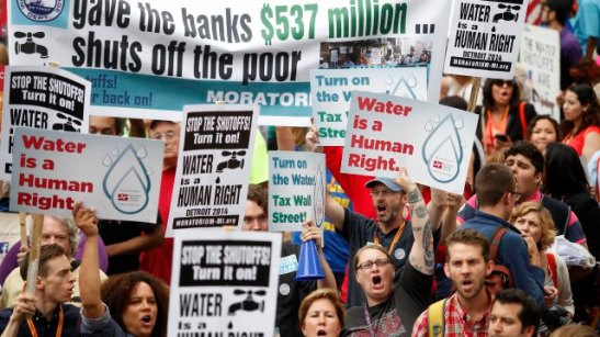 DETROIT, MI - JULY 18 : Demonstrators protest against the Detroit Water and Sewer Department July 18, 2014 in Detroit, Michigan. The Detroit Water and Sewer Department have disconnected water to thousands of Detroit residents who are delinquent with their bills. (Photo by Joshua Lott/Getty Images)