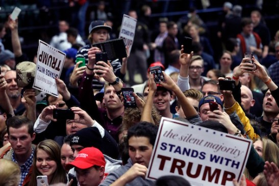 Republican presidential candidate, businessman Donald Trump supporters photograph the candidate at a campaign rally, Monday, Dec. 21, 2015, in Grand Rapids, Mich. (AP Photo/Carlos Osorio)
